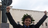 Graduation at Sapienza A student celebrates graduation <br /> near Minerva statue
